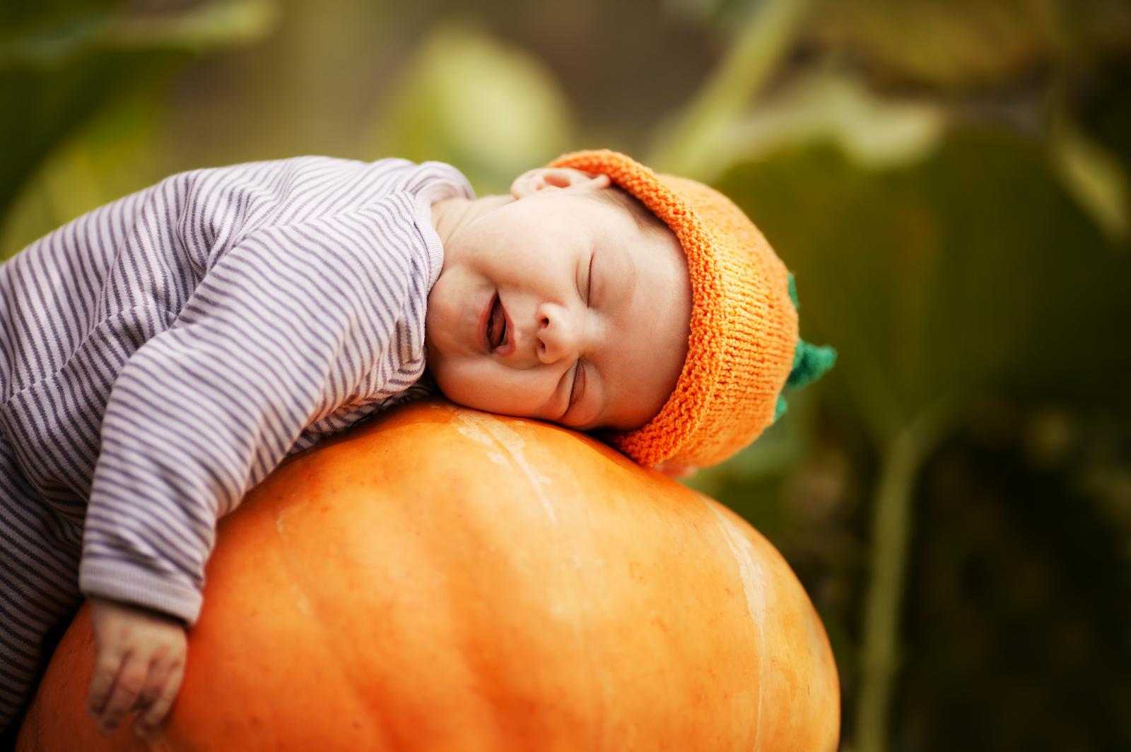 bigstock-baby-sleeping-on-big-pumpkin-41309152