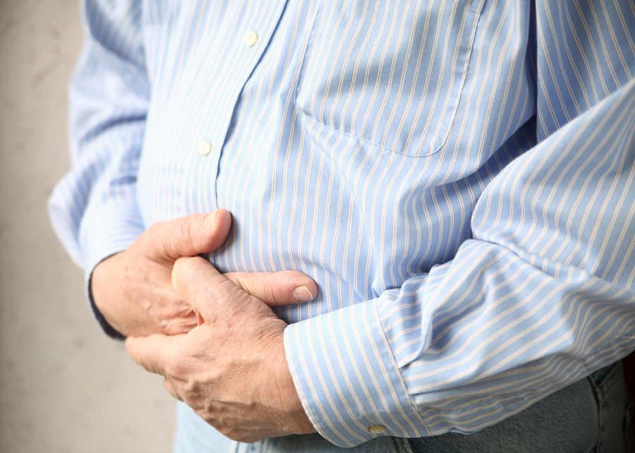 bigstock-businessman-with-bad-stomach-p-31621844