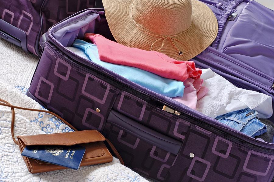 bigstock-Modern-luggage-partially-packe-15024971
