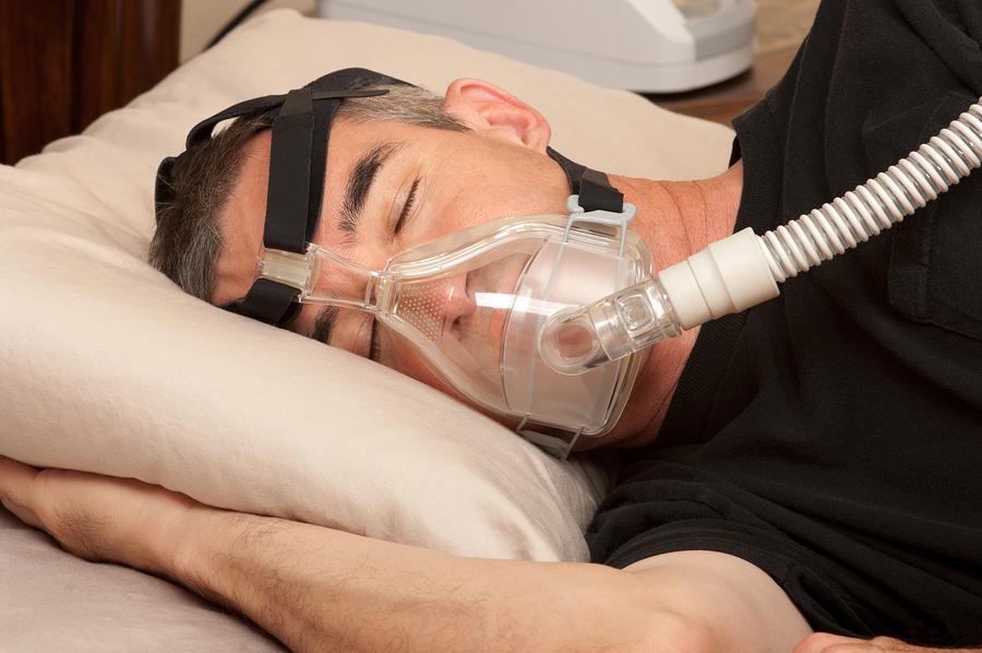 bigstock-Man-with-sleeping-apnea-and-CP-38537938