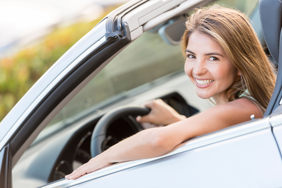 bigstock-Beautiful-woman-driving-a-car--44998648